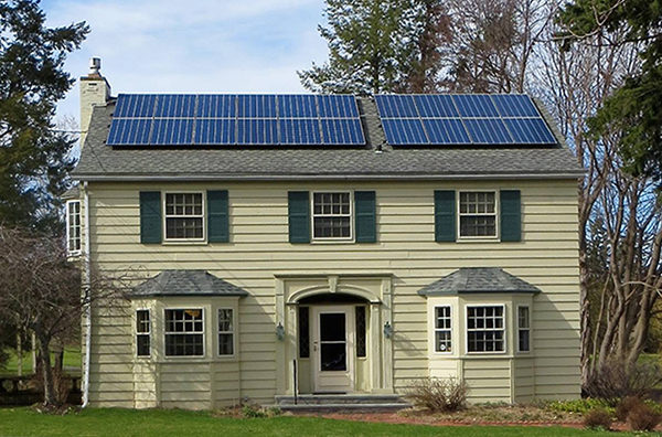 Handsome solar array on Classic colonial house outside the snowiest city in North America